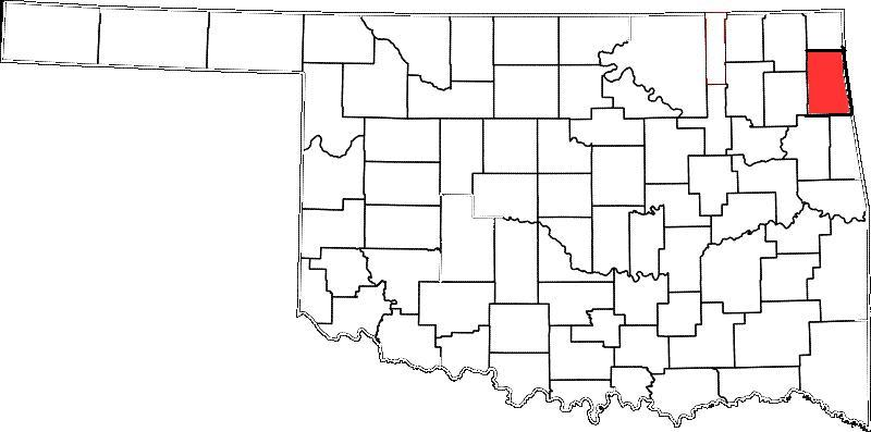 Delaware County, colored red, is east of Tulsa.