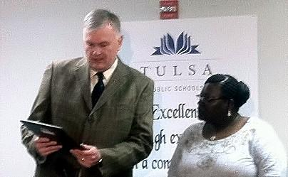 AAA's Neal Krueger presents award to Yolanda Palmer.