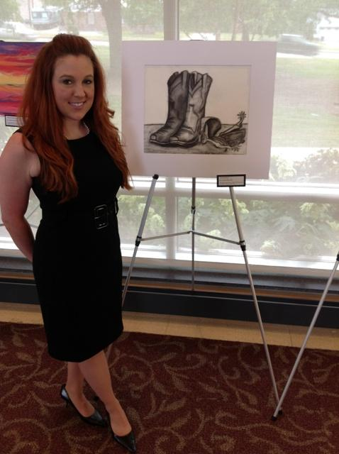 "Dr. Amanda Miles, with her charcoal drawing ""Boots and Roots"""