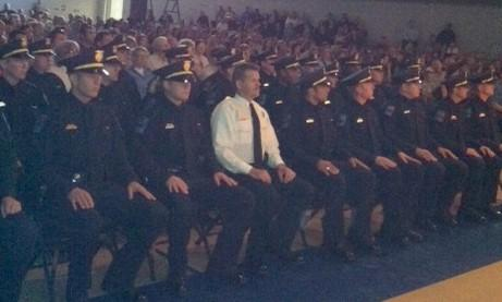 Police graduates await the oath of office