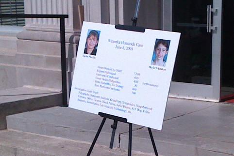 A poster outside the Okfuskee Court House with information on the death of two girls