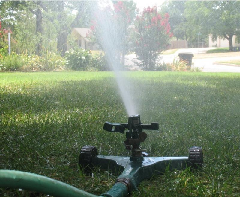 A sprinkler works in south Tulsa