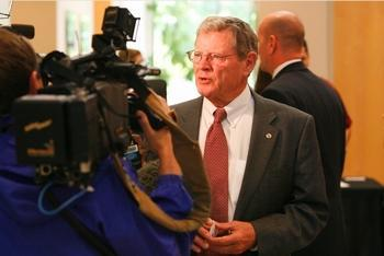 Senator Jim Inhofe talks with reporters