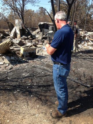 A FEMA officials inspects damage in Creek County