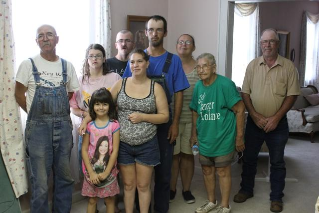 The Norwood family: (from left) Louis Sr., Vickie, Louis Jr., Kristle, George, Louise, Tammy and William, with (in front) Jesse Waldrich, Louis Sr.'s granddaughter