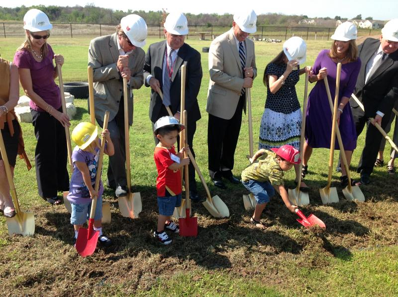 Union and CAP officials break ground, with the help of students (from left) Andi, Santi and Kareem.
