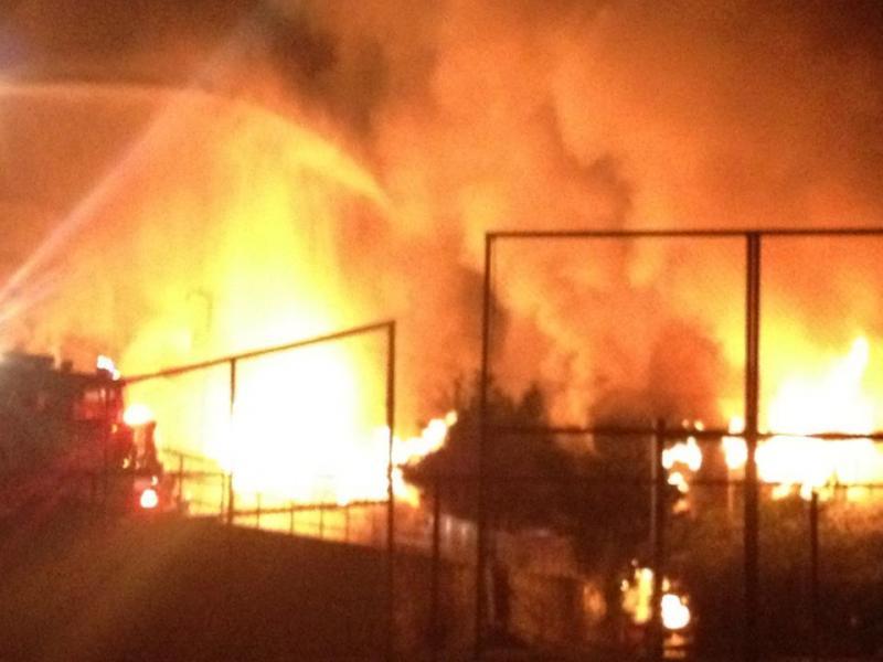 The pre-dawn fire spread rapidly through the building
