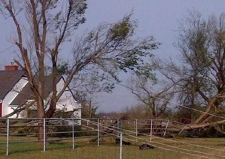 trees, power lines, fences and homes are damaged by the strong winds at Nowata