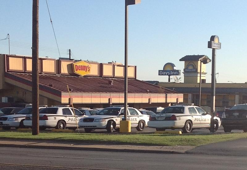 Tulsa Police surround the Days Inn Hotel at I-244 and Sheridan