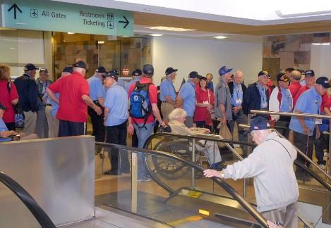 Veterans prepare to board the plane.