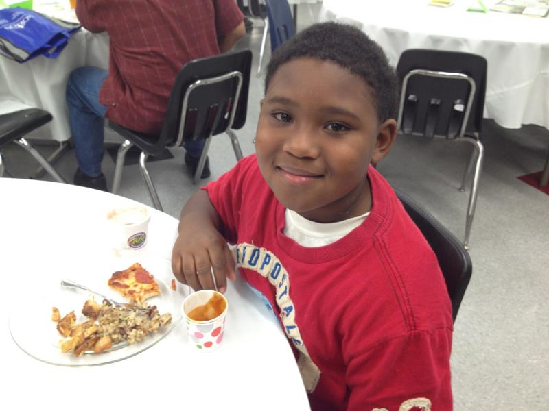 Burroughs Elementary third grader Kennedy Adams enjoys a meal of healthy options from several of North Tulsa's restaurants.