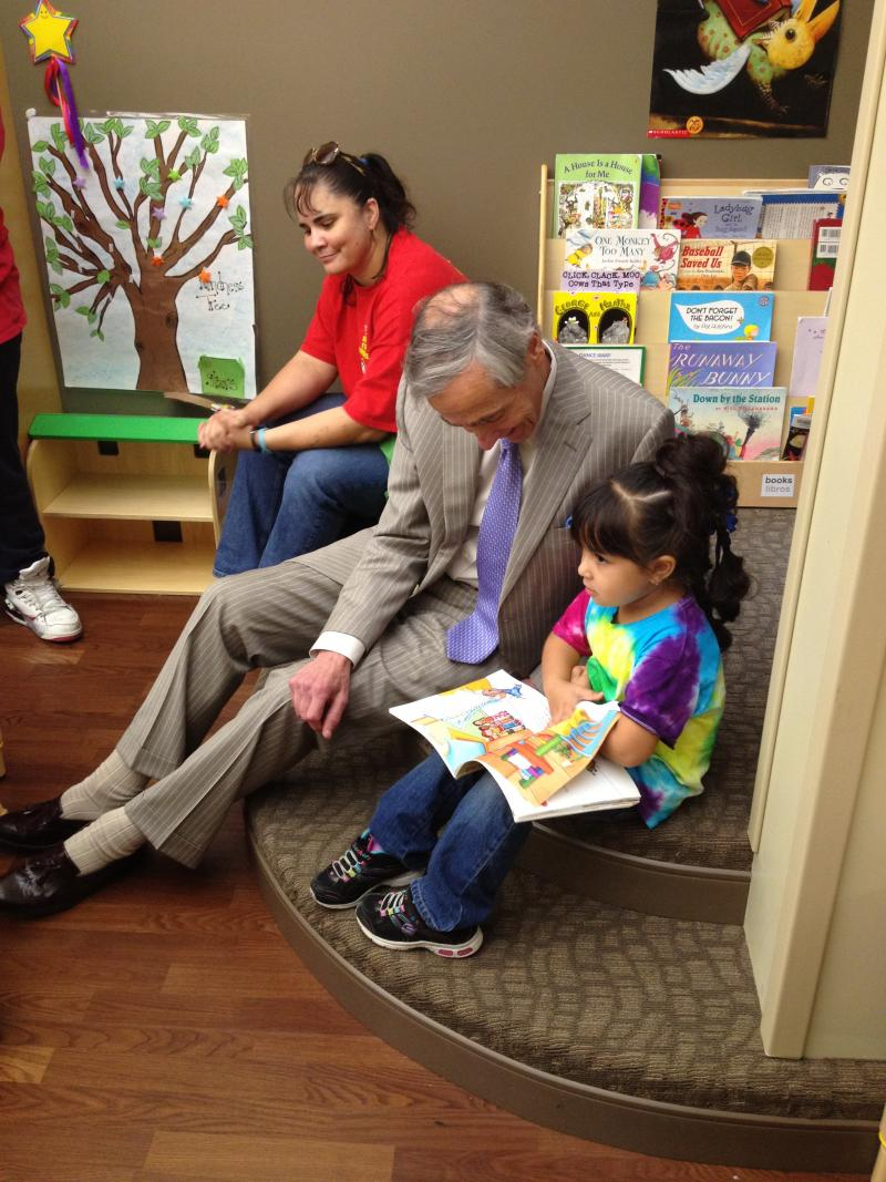 George Kaiser reads with an Educare student.