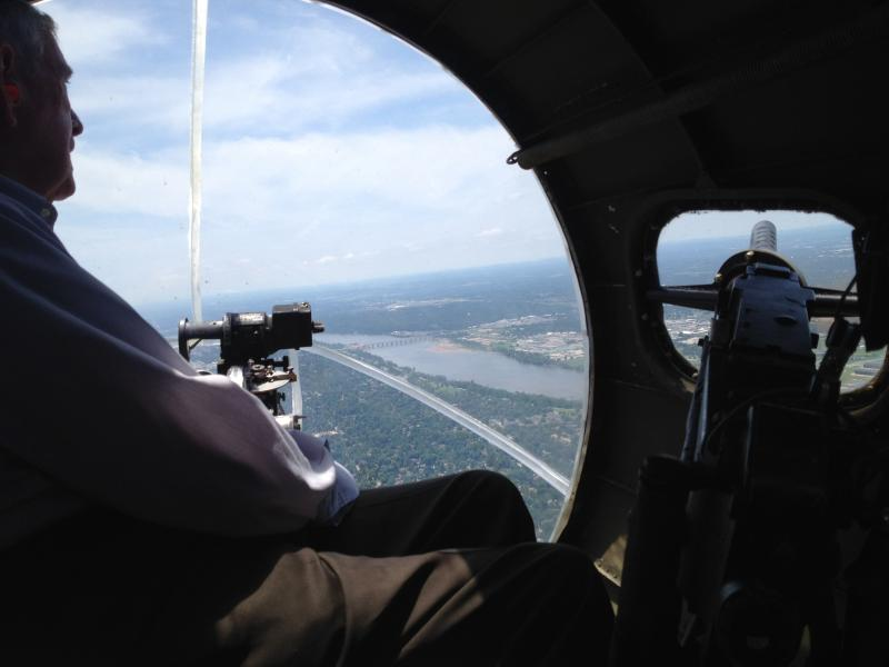 A veteran rides in the nose section of the Memphis Belle where the bombadier would sit.