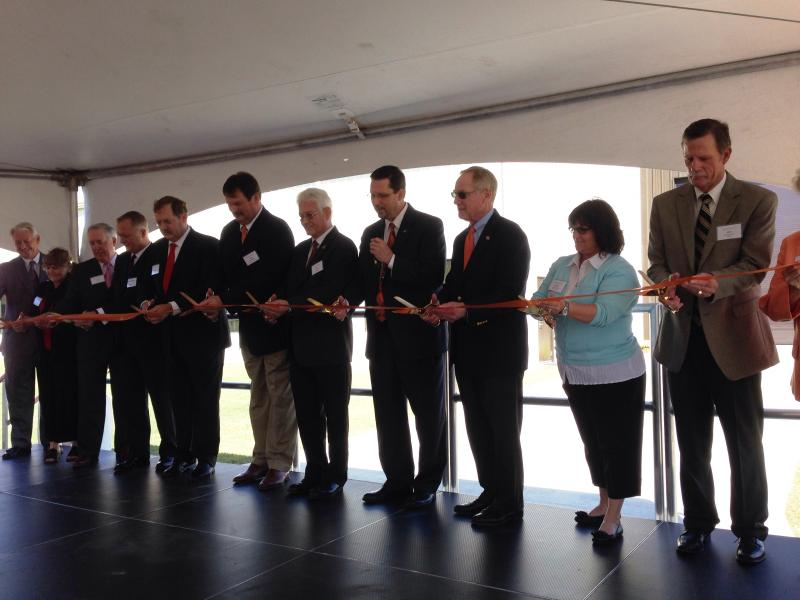 Oklahoma State University officials and energy company representatives cut the ribbon in front of a new natural gas compression training facility Wednesday.