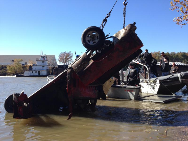 A larger tow truck, one big enough to handle an 18-wheeler, was able to lift the pickup out of the water, though it ended up upside-down.