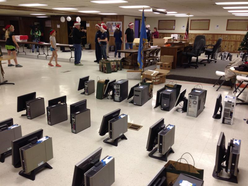 Volunteers bundle computers, monitors and peripherals Thursday at the Tulsa Fraternal Order of Police lodge.