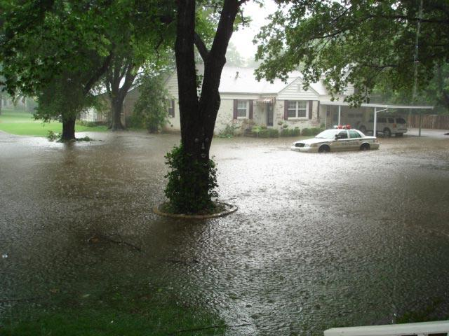 A June 2007 flood had water halfway up the wheels of a parked police car. City of Tulsa officials mentioned this incident specifically.