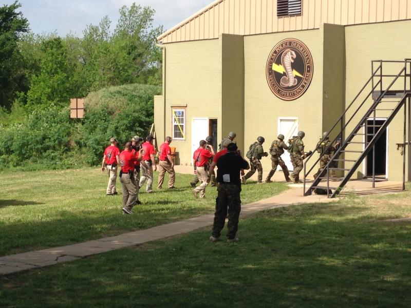 The Broken Arrow Police Department SWAT team enters the building where the hostage rescue event was staged.