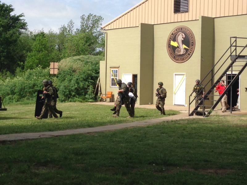Broken Arrow SWAT team members exit the building where the hostage rescue was staged. The hostage rescue was a timed event, and teams faced penalties for missing shooting targets or not being careful enough with the hostage.