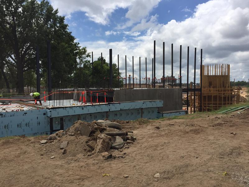 Several vertical steel beams that will hold the Williams Companies Lodge's glass exterior are in place.