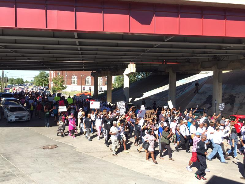 Marchers cross under the I-244 bridge over the Greenwood District on their march to city hall.