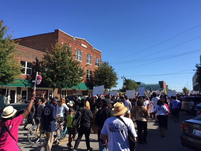 The march went through the Greenwood District on its way to city hall.