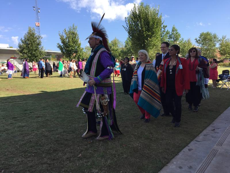 James Pepper Henry leads city and tribal dignitaries in a dance.