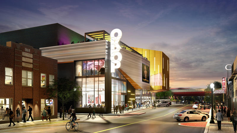 """Architects describe the concept behind OKPOP's design as """"grit and glitz."""" It will feature gray brick, black steel, glass, and illuminated silver and gold metal panels."""