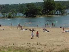 People playing in the water at Taylor's Ferry on Fort Gibson Lake