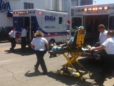 A student is rushed to a waiting ambulance.