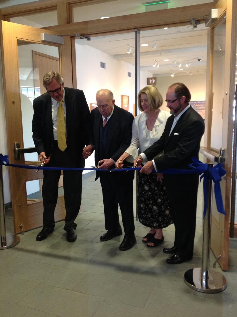 Dr. Steadman Upham and Henry Zarrow, along with his two children, cut the ribbon on the new Zarrow Center