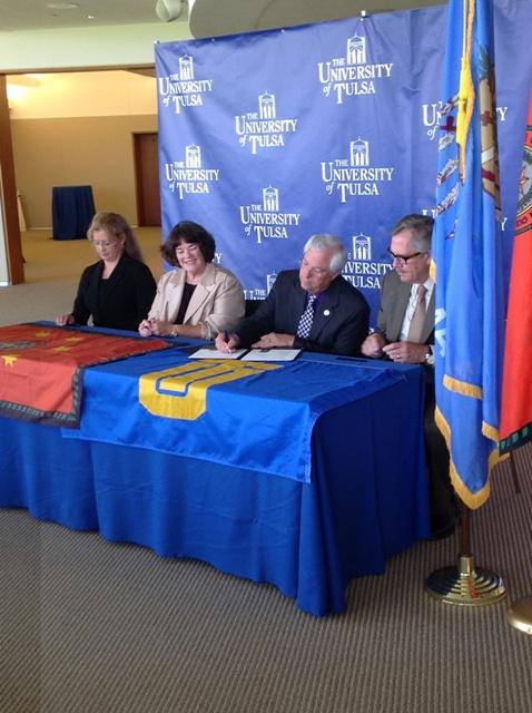 Cherokee Principal Chief Bill John Baker signs the scholarship agreement with the University of Tulsa.
