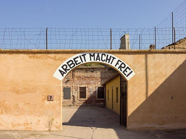 Theresienstadt concentration camp archway with the phrase Arbeit macht frei (work makes (you) free), placed over the entrance in a number of Nazi concentration camps