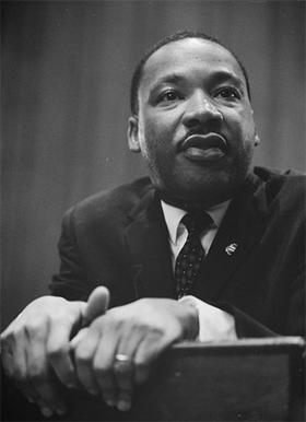 Dr. Martin Luther King, Jr. leaning on a lectern on March 26, 1964. Monday, Jan. 17 is a national holiday, one that some will be using as an opportunity to serve their communities.
