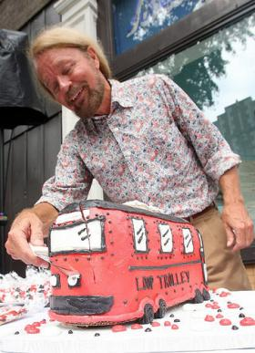 In July 2010, developer Joe Edwards cut a ceremonial trolley cake following the announcement that the St. Louis area received nearly $25 million in federal dollars for a new trolley system.