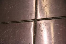 Some of the welds of the Gateway Arch, as pictured in 2010, along with some of the graffiti adorning its surface.