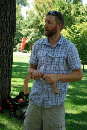 Guide Jon Richard holds a cambium loop. Ropes go through the loop than then fits over a branch, protecting it from any rubbing.