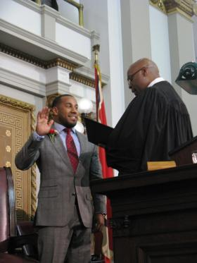 Judge Jimmie Edwards administers the oath of office to Ald. Chris Carter, who will fill the seat of his late uncle.