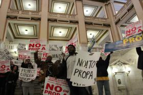 Activists rally at St. Louis City Hall against Proposition A.