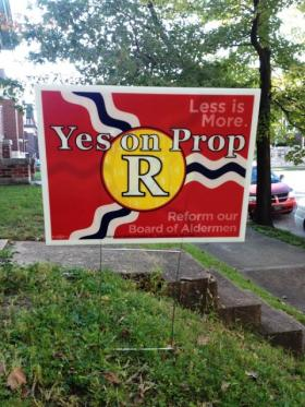 A yard sign in support of reducing the Board of Aldermen