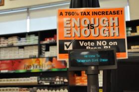 Opponents of a cigarette tax increase have distributed signs like this one all over Missouri. They're displayed at many gas stations, leading some voters to believe Prop B would increase the price of gasoline.