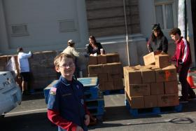 Cub Scout Timmy Gibson helps collect food at a fire station in University City on Nov. 17, 2012.