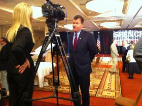 Republican gubernatorial candidate and St. Louis businessman Dave Spence (standing) on election night, Nov. 6, 2012.