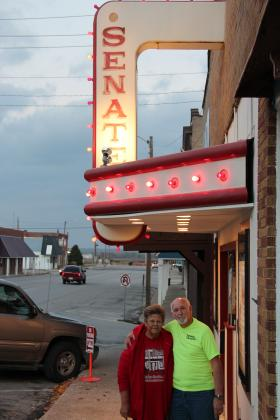 Sandra and Bob Sinnett stand outside the Senate Theater in Elsberry, Mo.