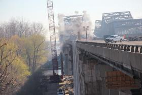 Crews blast off part of the Blanchette Bridge on Sunday, Nov. 18.
