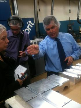Spence takes a few members of the media on a tour of Alpha Packaging.