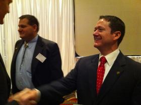 Speaker Tim Jones shakes hands with attendees after the forum.