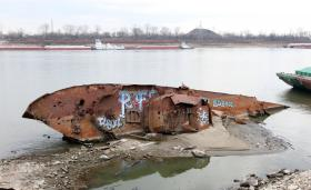 The USS Inaugural minesweeper, lays on its side exposed on a sand bar on the Mississippi River south of St. Louis on December 7, 2012.