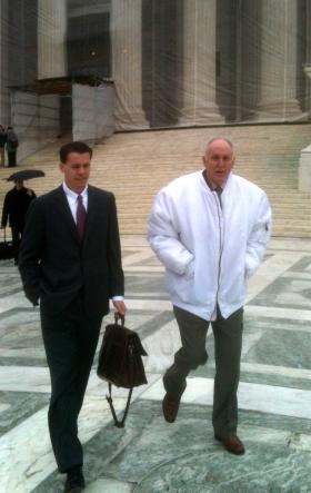 Bowman (at right) and his lawyer Mark P. Walters outside the U.S. Supreme Court building on Jan. 19.