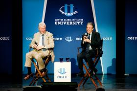 President Clinton and John Steward at the 2012 CGIU